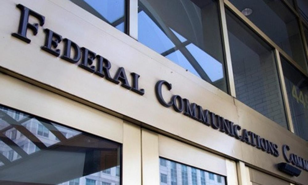 FCC	Spectrum	Auction and Channel Sharing